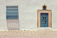 Tunisia, Sidi Bou Said.  Door and Window.  Blue and white are the traditional colors of the houses of Sidi Bou Said.