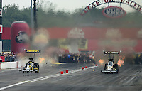 Sept. 1, 2012; Claremont, IN, USA: NHRA top fuel dragster driver Morgan Lucas (left) races alongside Tony Schumacher during qualifying for the US Nationals at Lucas Oil Raceway. Mandatory Credit: Mark J. Rebilas-