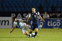 The USA's (3) Carlos Bocanegra is tackled by Guatemala's (15) Manuel Leon as the United States played Guatemala at Estadio Mateo Flores in Guatemala City, Guatemala in a World Cup Qualifier on Tue. June 12, 2012.
