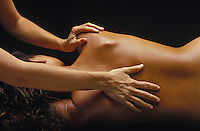 Woman receiving a relaxing massage at island health spa