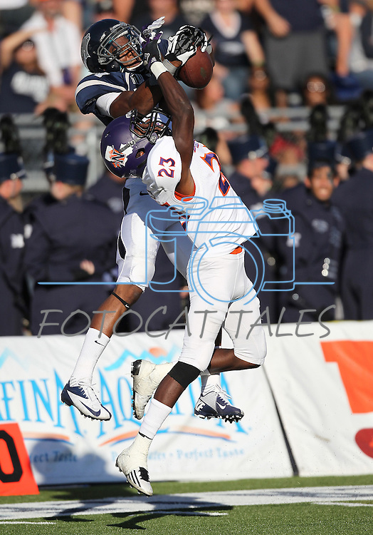 Nevada's Aaron Bradley (81) attempts a catch near the end zone against Northwestern State's Fred Thomas during the first half of an NCAA college football game Saturday, Sept. 15, 2012, in Reno, Nev. (AP Photo/Cathleen Allison)
