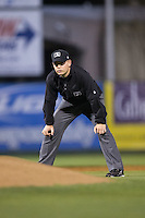 Umpire Ryan Powers handles the calls on the bases during the South Atlantic League game between the Hickory Crawdads and the Kannapolis Intimidators at Kannapolis Intimidators Stadium on April 8, 2016 in Kannapolis, North Carolina.  The Crawdads defeated the Intimidators 8-2.  (Brian Westerholt/Four Seam Images)