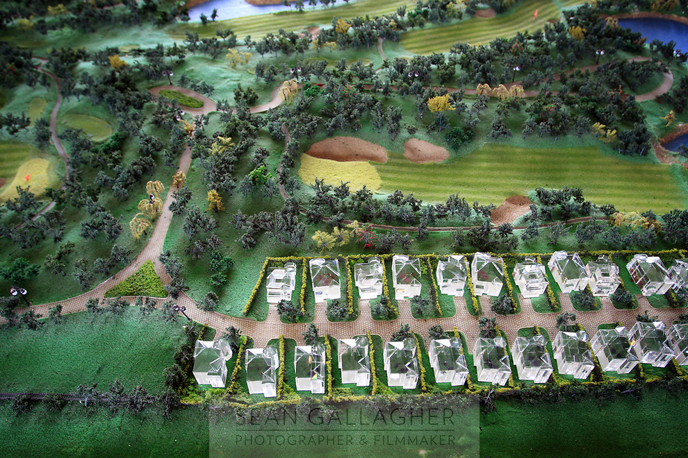 CHINA. A model displays the location of properties which line the Huatang International Golf Club in Beijing. In the club's sales office. 2009