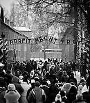 Visitors walk under the sign Arbeit macht frei ( Work brings freedom ) at the entrance of Auschwitz I concentration camp Sunday Dec 28 2014. Auschwitz concentration camp was a network of German Nazi concentration camps and extermination camps built and operated by the Third Reich in Polish areas annexed by Nazi Germany during World War II, the camp was liberated on January 27, 1945 by Soviet troops. Photo By Eyal Warshavsky