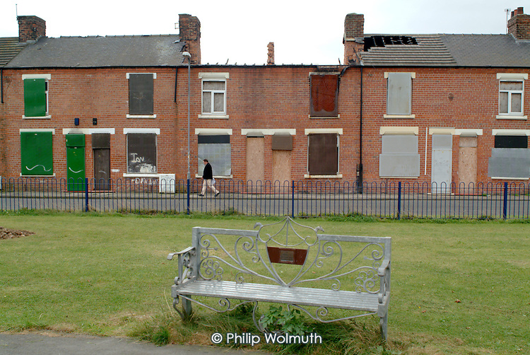 Newly landscaped park, on the site of a demolished street, surrounded by boarded up empty and vandalised terraced housing in a low demand area of South Bank, Middlesborough.