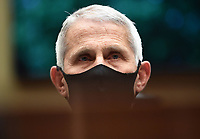 Director of the National Institute for Allergy and Infectious Diseases Dr. Anthony Fauci wears a face mask while he waits to testify before the House Committee on Energy and Commerce on the Trump Administration's Response to the COVID-19 Pandemic, on Capitol Hill in Washington, DC on Tuesday, June 23, 2020.   <br /> Credit: Kevin Dietsch / Pool via CNP/AdMedia