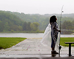 "(TAKE ME FISHING)--30370--On Sat June 7,2003-fish0607a--Natalie Ghigliotty, age 7 of South Amboy waits for the heavy rain to slow so she could go out and start fishing during the ""Take Me Fishing"" day at Cheesequake State Park in Old Bridge Twp. The NJ Divison of Fish & Wildlife is sponsoring the event. (MARK R. SULLIVAN/HNT CHIEF PHOTOGRAPHER)"