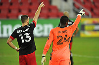 WASHINGTON, DC - SEPTEMBER 27: Frederic Brilliant #13 and Bill Hamid #24 of D.C. United during a game between New England Revolution and D.C. United at Audi Field on September 27, 2020 in Washington, DC.