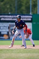 State College Spikes shortstop Delvin Perez (23) leads off second base during a game against the Batavia Muckdogs on July 8, 2018 at Dwyer Stadium in Batavia, New York.  Batavia defeated State College 8-3.  (Mike Janes/Four Seam Images)
