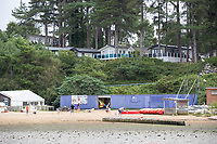 BNPS.co.uk (01202) 558833. <br /> Pic: BNPS<br /> <br /> Pictured: Holiday homes at Rockley Park above the beach at Rockley Point in Poole Harbour, Dorset. <br /> <br /> There are fresh calls for a holiday park to increase safety measures at a notorious beach where one swimmer has drowned and almost 20 children rescued this summer. <br /> <br /> In the latest incident a dad and his two young sons were plucked to safety in the nick of time after they were swept away by a rip tide at Rockley Park in Poole Harbour, Dorset.<br /> <br /> It happened a month after hero swimmer Callum Baker-Osborne, 18, drowned while helping to rescue 13 children at the same spot.<br /> <br /> And before that two young girls were saved from drowning by a paddleboarder.