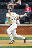Matt Conway (25) of the Wake Forest Demon Deacons follows through on his swing against the Virginia Cavaliers at Wake Forest Baseball Park on May 17, 2014 in Winston-Salem, North Carolina.  The Demon Deacons defeated the Cavaliers 4-3.  (Brian Westerholt/Four Seam Images)