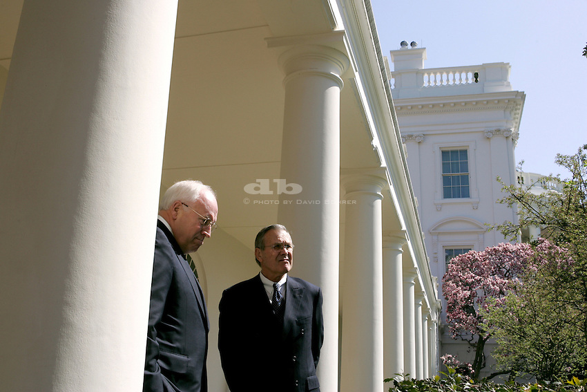 Vice President Dick Cheney and Secretary of Defense Donald Rumsfeld talk while standing in the colonade outside the Rose Garden before walking to the Residence for lunch with President Bush and President of the Ukraine Viktor Yushenko. .PON   .COS JUMBO 20x30 Jumbos for Scooter's Office.  . Used in the 2006 Radio and Television Correspondents' Association Annual Dinner Slide Show.APRIL 2005 SCRAPBOOK