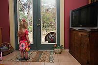 Wild Turkey (Meleagris gallopavo), Girl watching turkey displaying, New Braunfels, Central Texas, USA