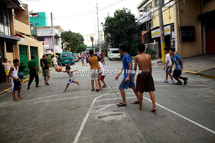 Filipino youth play basketball at the Benitez St. Quirino Avenue in Malate, Manila in Philippines. Photo: Sanjit Das