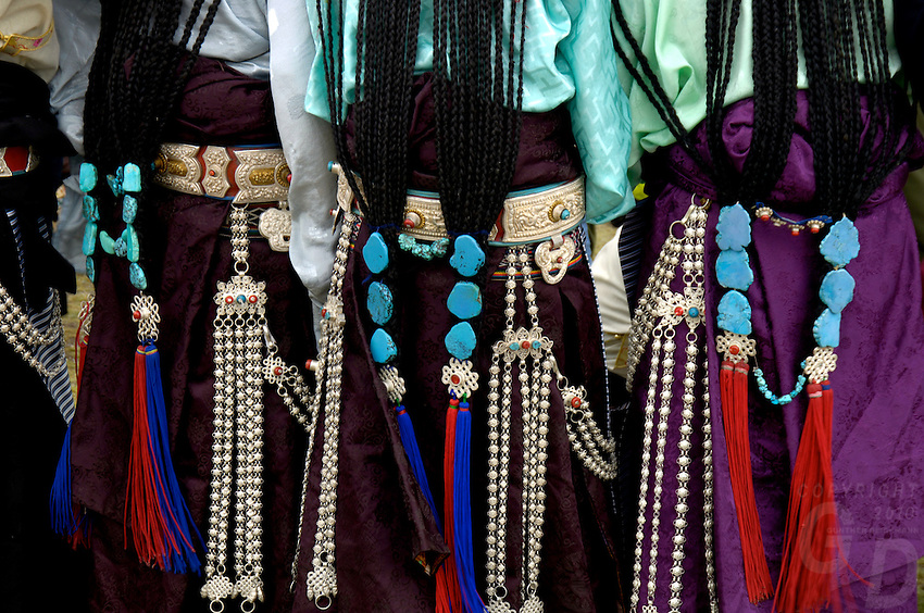 Tibetan Girls and women dress in their most colorful Costumes during the annual Naqu Horse Racing festival, the highest in the world at 4800 meters, more than 10,000 people cross high passes by foot, horse and jeep to be part of this festival