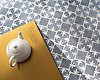 Fleur de Lys, a waterjet stone mosaic, shown in polished Bardiglio, Calacatta Gold, and Brass, is part of the Jardins Français™ collection by Caroline Beaupere for New Ravenna.<br /> <br /> -Counter courtesy of Grothouse Solid Wood Surfaces.<br /> www.glumber.com