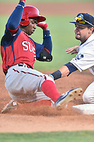 Hagerstown Suns center fielder Victor Robles (16) slides into third base as Max George (3) attempts to make a tag during a game against the Asheville Tourists at McCormick Field on June 8, 2016 in Asheville, North Carolina. The Tourists defeated the Suns 10-8. (Tony Farlow/Four Seam Images)
