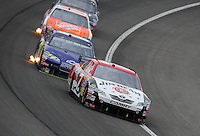 Feb 22, 2009; Fontana, CA, USA; NASCAR Sprint Cup Series driver Robby Gordon leads David Gilliland during the Auto Club 500 at Auto Club Speedway. Mandatory Credit: Mark J. Rebilas-