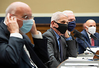 From left to right, Dr. Robert Redfield, Director, Centers for Disease Control and Prevention; Dr. Anthony Fauci, Director, National Institute for Allergy and Infectious Diseases, National Institutes of Health; ADM Brett P. Giroir, Assistant Secretary for Health U.S. Department of Health and Human Services; and Dr. Stephen M. Hahn, Commissioner, U.S. Food and Drug Administration; testify during a House Energy and Commerce Committee hearing on the Trump Administration's Response to the COVID-19 Pandemic, on Capitol Hill in Washington, DC on Tuesday, June 23, 2020. <br /> Credit: Kevin Dietsch / Pool via CNP/AdMedia