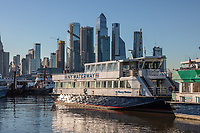 A NY Waterway ferry docked in Weehawken, NJ with the Hudson Yards Development in Manhattan in the background.