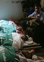 Palestinian relatives of one of 6 hamas militants were killed by an Israeli air strike, mourn over his lifless body at the mosque during his funeral in Buraije refugee camp, Cinteral Gaza Strip, Tuesday, Aug. 21, 2007. (FADY ADWAN)