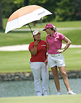 SINGAPORE - MARCH 08:  Jiyai Shin of South Korea talks with Paula Creamer of the USA on the par tree 11th hole during the final round of HSBC Women's Champions at the Tanah Merah Country Club on March 8, 2009 in Singapore.  Photo by Victor Fraile / The Power of Sport Images