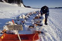 John Baker Gets Food from Drop Bags Eagle Island