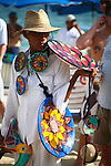 MAN SELLS WARES ON BEACH IN CABO SAN LUCAS (2)