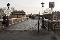 """Ponte Sisto.<br /> <br /> Rome, 12/03/2020. Documenting Rome under the Italian Government lockdown for the Outbreak of the Coronavirus (SARS-CoV-2 - COVID-19) in Italy. On the evening of the 11 March 2020, the Italian Prime Minister, Giuseppe Conte, signed the March 11th Decree Law """"Step 4 Consolidation of 1 single Protection Zone for the entire national territory"""" (1.). The further urgent measures were taken """"in order to counter and contain the spread of the COVID-19 virus"""" on the same day when the WHO (World Health Organization, OMS in Italian) declared the coronavirus COVID-19 as a pandemic (2.).<br /> ISTAT (Italian Institute of Statistics) estimates that in Italy there are 50,724 homeless people. In Rome, around 20,000 people in fragile condition have asked for support. Moreover, there are 40,000 people who live in a state of housing emergency in Rome's municipality.<br /> March 11th Decree Law (1.): «[…] Retail commercial activities are suspended, with the exception of the food and basic necessities activities […] Newsagents, tobacconists, pharmacies and parapharmacies remain open. In any case, the interpersonal safety distance of one meter must be guaranteed. The activities of catering services (including bars, pubs, restaurants, ice cream shops, patisseries) are suspended […] Banking, financial and insurance services as well as the agricultural, livestock and agri-food processing sector, including the supply chains that supply goods and services, are guaranteed, […] The President of the Region can arrange the programming of the service provided by local public transport companies […]».<br /> Updates: on the 12.03.20 (6:00PM) in Italy there 14.955 positive cases; 1,439 patients have recovered; 1,266 died.<br /> <br /> Footnotes & Links:<br /> Info about COVID-19 in Italy: http://bit.do/fzRVu (ITA) - http://bit.do/fzRV5 (ENG)<br /> 1. March 11th Decree Law http://bit.do/fzREX (ITA) - http://bit.do/fzRFz (ENG)<br /> 2. http://bit.do/fzRKm"""