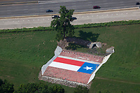 aerial photograph of a mural by Kyle Wadsworth  of the Texas Flag painted on a concrete slab at the side of interstate I-30, Dallas, Texas; the mural was commissioned by Chris Aslam and is located off the eastbound service road to I-30 at Beckley Avenue and Sylvan Avenue.