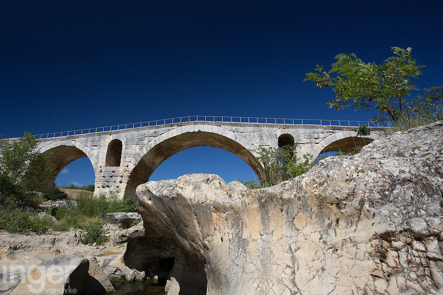The ancient stone bridge of Pont Julien in Provence, France