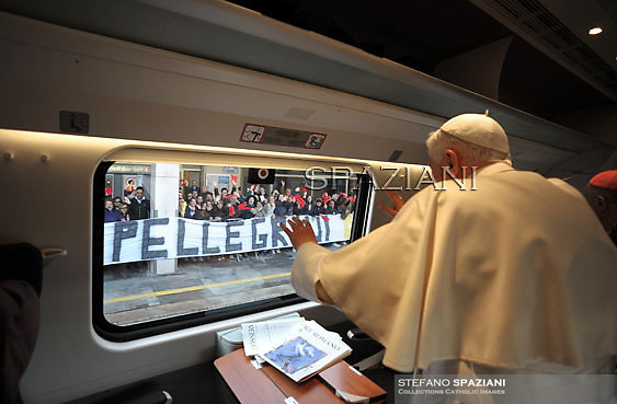 """Pope Benedict XVI reading in the train on his way to Assisi to attend the interreligious talks on October 27, 2011. Pope Benedict XVI will lead during the day the 25th Interreligious talks, a """"journey of reflection, dialogue and prayer for peace and justice in the world"""" held in St. Francis of Assisi's birthplace,  October 27, 2011 in Assisi.Italy"""