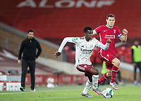 1st October 2020; Anfield, Liverpool, Merseyside, England; English Football League Cup, Carabao Cup, Liverpool versus Arsenal; Eddie Nketiah of Arsenal shields the ball from James Milner of Liverpool