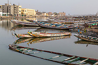 Senegal, Saint Louis.  Fishing Boats Resting on the Riverbank of the River Senegal, late afternoon.