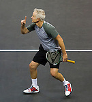 John McEnroe (USA) loses to James Blake, 7-5,  at the PowerShares Champions Cup, in Boston, Massachusetts on April 22, 2015.