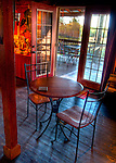 A table stands in the light of the open door in the tasting room at Sans Soucy Vineyards and Winery, in Brookneal Virginia.  (HDR image)