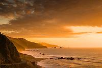 Intense sunset over rugged coastline with State Highway 6 near Punakaiki, Buller Region, West Coast, New Zealand