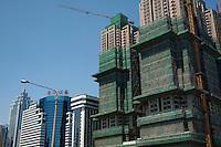 Construction crane and skyscrapers, Shenzhen, Guangdong, China.
