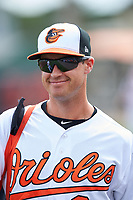 Baltimore Orioles Logan Schafer (28) walks to the dugout before a Spring Training exhibition game against the Dominican Republic on March 7, 2017 at Ed Smith Stadium in Sarasota, Florida.  Baltimore defeated the Dominican Republic 5-4.  (Mike Janes/Four Seam Images)