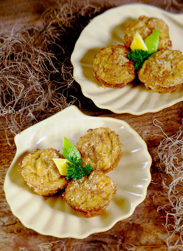 Deviled Crab cakes on shell dishes with lemon and lime decoration