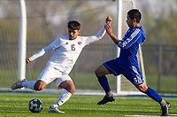 Samuel Hernández (5) of Rogers and Jesus Castaneda (15) of Springdale battle for the ball at Whitey Smith Stadium, Rogers High School, Rogers, Arkansas, on Friday, April 2, 2021 / Special to NWA Democrat Gazette David Beach