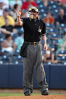 Home plate umpire Scott Mahoney during a game between the Akron Aeros and Trenton Thunder at Canal Park on July 26, 2011 in Akron, Ohio.  Trenton defeated Akron 4-3.  (Mike Janes/Four Seam Images)