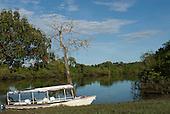 Xingu Indigenous Park, Mato Grosso State, Brazil. Port of Aldeia Matipu. The 'Coração do Brasil' voadeira aluminium boat of the Heart of Brazil Expedition.
