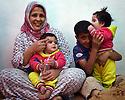 TRAUMA HEALING CASE STUDIES. SARAA AREF, 30 AND THREE OF HER SIX CHILDREN, IRBID, JORDAN. 20/4/16. PHOTO BY CLARE KENDALL.