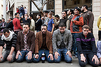 Protesters kneel down to pray on a street in central Cairo. Continued anti-government protests take place in Cairo calling for President Mubarak to stand down. After dissolving the government, Mubarak still refuses to step down from power.