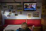 Runcorn Town 1 Runcorn Linnets 0, 26/12/2013. The Pavilions, North West Counties League Premier Division. TV commentator John Motson on a television set in the tea room inside the ground before the Boxing Day derby match between Runcorn Town and visitors Runcorn Linnets at the Pavilions, Runcorn, in a top-of the table North West Counties League premier division match. Runcorn Linnets won 1-0 and overtook their neighbours at the top of the league in a game watched by 803 spectators. Runcorn Linnets were a successor club to Runcorn FC, one of England foremost non-League clubs of the 1970s and 1980s. Photo by Colin McPherson.