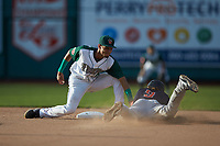 Fort Wayne TinCaps shortstop Tucupita Marcano (15) applies a tag to Ford Proctor (9) of the Bowling Green Hot Rods as he attempts to steal second base at Parkview Field on August 20, 2019 in Fort Wayne, Indiana. The Hot Rods defeated the TinCaps 6-5. (Brian Westerholt/Four Seam Images)