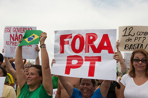 Protesters with 'Fora PT' (Worker's Party Out) banner. Rio de Janeiro, Brazil, 15th March 2015. Popular demonstration against the President, Dilma Rousseff in Copacabana. Photo © Sue Cunningham sue@scphotographic.com.