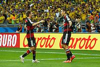 Miroslav Klose of Germany celebrates scoring a goal Philipp Lahm after making it 0-2