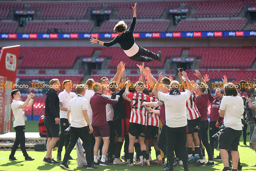 Brentford Manager, Thomas Frank is thrown in the air by his team and coaching staff to celebrate promotion to the Premier League during Brentford vs Swansea City, Sky Bet EFL Championship Play-Off Final Football at Wembley Stadium on 29th May 2021